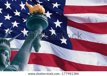This is a digitally created image of the American flag and Statue of Liberty. The head, arm and torch from the Statue is superimposed into the left hand side of the flag.  - stock photo