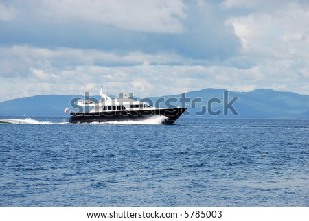 This is a fast motorboat which moving to the port