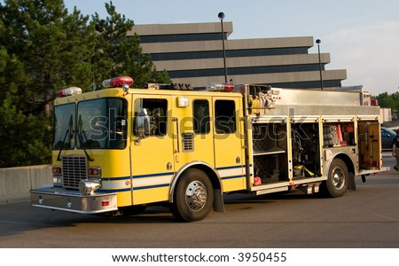 This is a fire department pumper rescue truck. - stock photo