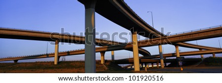 This is a freeway overpass intersection. It is the Interstate 10 & 15 in Southern California. The freeway criss-crosses over itself in several different directions. - stock photo