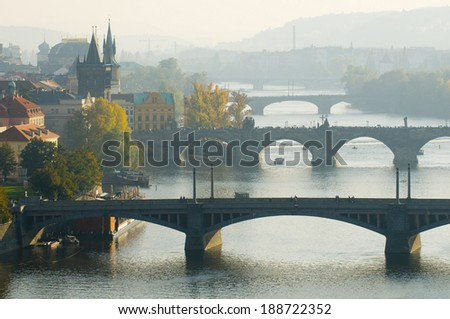 This is a general view of Prague in autumn. Famous bridges across Vltava river are blotted out by the fog. - stock photo