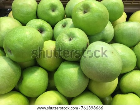 This is a photo of green apples. They are so good and fresh. They will be a perfect choice for people who love fruits.