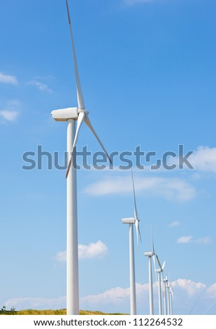 This is a photograph of a wind farm that I have taken in August.