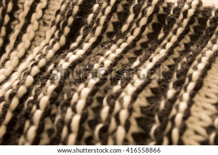 This is a photograph of Black and White winter scarf