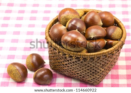 This is a photograph of chestnuts that was served in a basket that I have taken in the fall. - stock photo