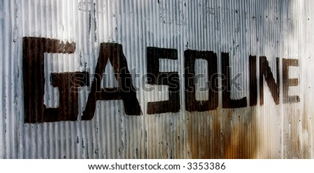 This is a picture of an old sign hand painted on a corrugated steel wall from an old abandoned gas station. photo from left to right. - stock photo