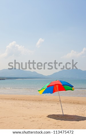 This is a picture of the sea and beach umbrellas of summer I was taken in summer. - stock photo