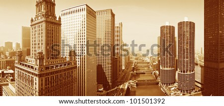 This is a sepiatone view looking over the Chicago River. The skyline surrounds the river. - stock photo