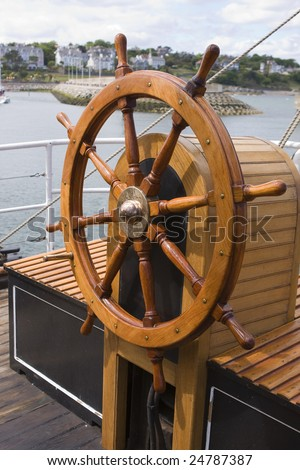 this is a ships wheel from a tall ship - stock photo