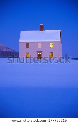This is a single home all by itself. It has no neighbors and sits alone in a field. It is located on Darling Hill Road.  Mount Burke is seen in the background with snow.  - stock photo