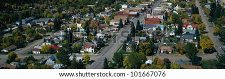 This is a small town in the western part of the United States. It is autumn and shows small town America with houses lined up on tree lined suburban streets. - stock photo