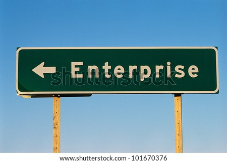 This is a street sign that says Enterprise. - stock photo