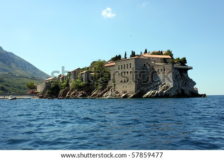this is a Sveti Stefan, on the Montenegro coast, view from the sea. - stock photo