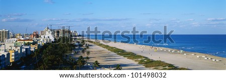 This is a view along the beach and ocean of South Beach Miami. - stock photo