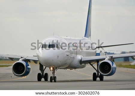 This is a view of Small Planet Poland plane Airbus A320 registered as SP-HAC on the Warsaw Chopin Airport. July 30, 2015. Warsaw, Poland.