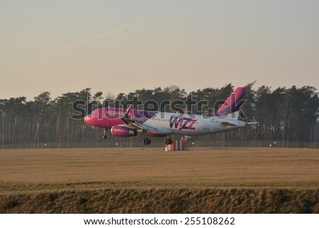 This is a view of Wizzair plane Airbus A320 registered as HA-LWX landing on the Lublin Airport. February 20, 2015. Lublin Airport in Swidnik, Poland