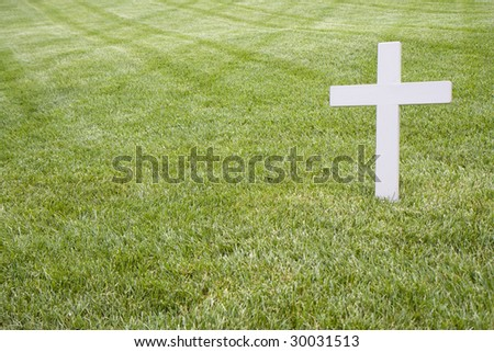 This is a White Cross in Grass above RFK's grave - stock photo