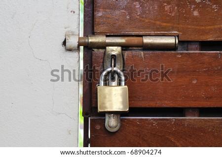 This is a wooden door.It lock - stock photo