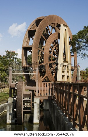 This is a wooden watermill, in a rice producing area of Taiwan.
