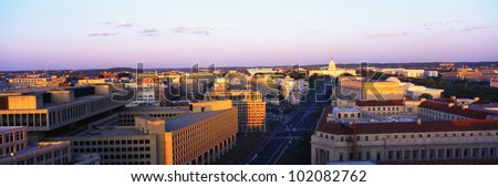 This is an aerial view of Washington, DC showing Pennsylvania Avenue to the U.S. Capitol at sunset. - stock photo