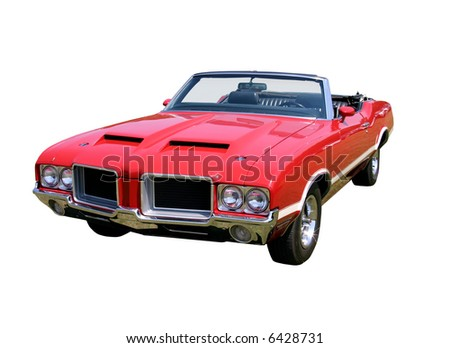 This is an early 1970s red convertable mussle car taken at a car show. isolated on white. - stock photo