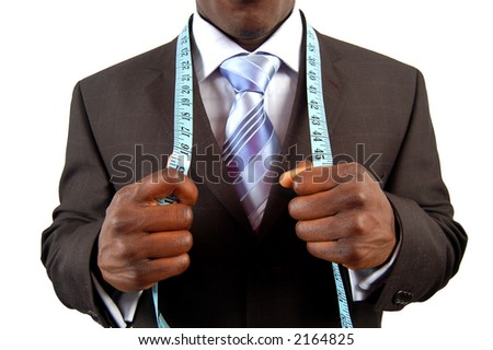 This is an image of a black business man, wearing measuring tape. - stock photo
