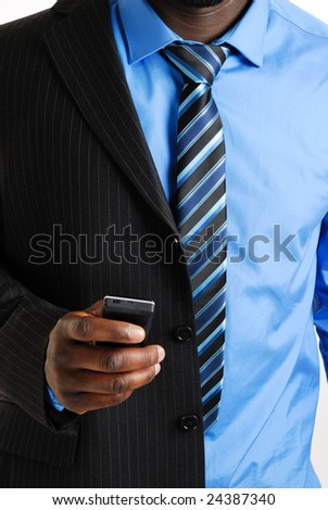 This is an image of a business man using his phone. - stock photo