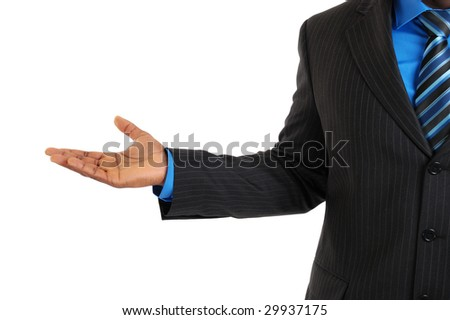 This is an image of a business man with his hand stretched out.