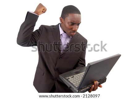 "This is an image of a businessman frustrated at his laptop. This image can be used to represent ""Slow Laptop"" ""Internet fraud"" etc... - stock photo"