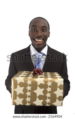 This is an image of a businessman holding a big parcel, to be offered as a christmas present. - stock photo