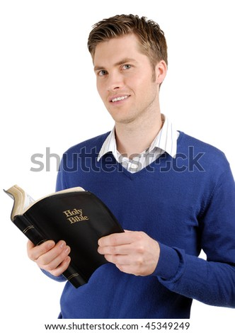 This is an image of a man reading the bible. - stock photo