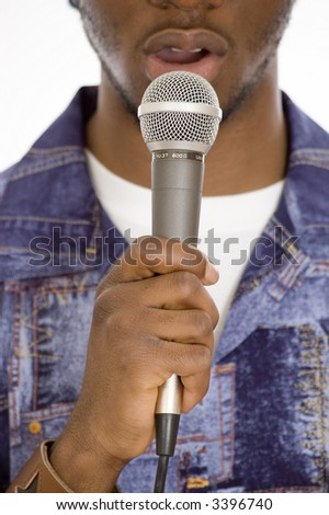 This is an image of a man's hand on a microphone. - stock photo