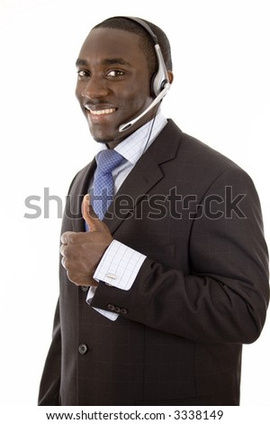 This is an image of a man with a microphone headset, giving thumbs up. This image can be used for telecommunication and service themes. - stock photo