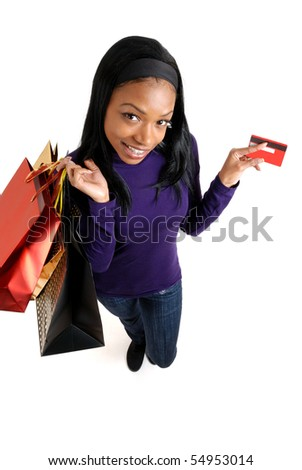 This is an image of a woman holding a shopping bag and credit card.