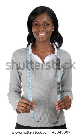 This is an image of business woman using a measuring tape.