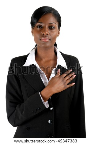 This is an image of business woman with hand across his chest.