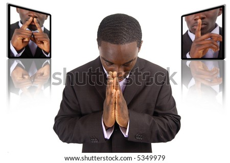 This is an image of businessman emphasising the need for silence, during prayer time. - stock photo