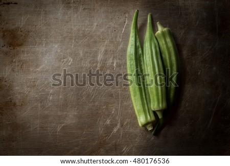 This is an image of home grown Okra or Okro which is a flowering plant in the mallow family. It is a Southern dish that is a favorite as fried or used in gumbo. Also know as Ladies Fingers.
