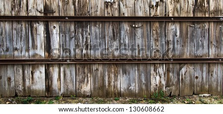 This is an old wood fence in old Montreal with rusty metal. Very contrasty texture with a lot of details. - stock photo