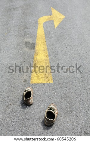 This is arrow sign on the road - stock photo