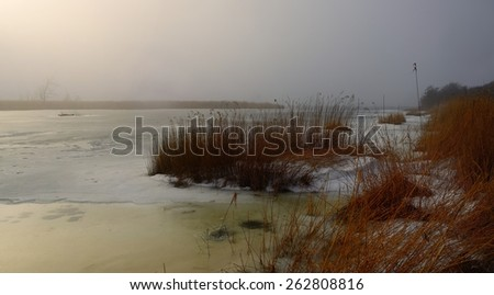 This is cold morning in Caucasus lake in winter - stock photo