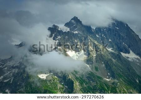 This is gloomy peak in Caucasus mountains in summer - stock photo