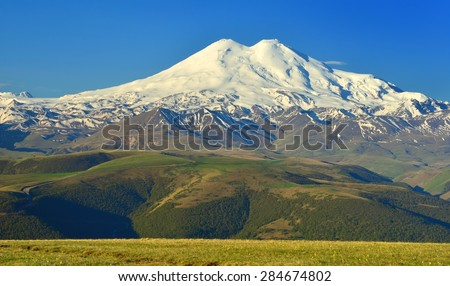 This is huge Elbrus in Caucasus mountains in beginning summer