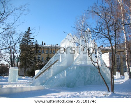 This is ice slide on winter city square - stock photo