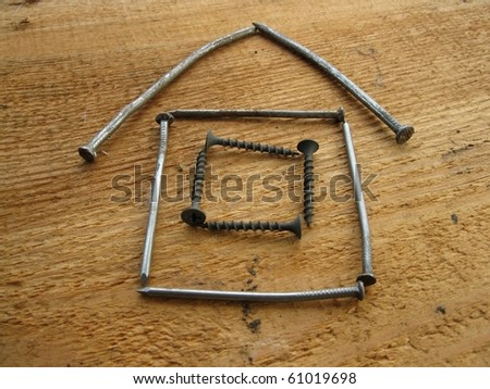 This is model of a house prepared  from nails - stock photo