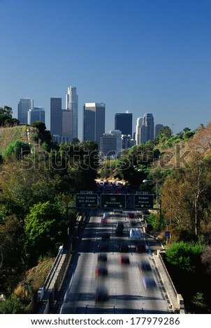 This is morning rush hour traffic on the Pasadena Freeway. It is near Dodger Stadium with the skyline in the background. - stock photo