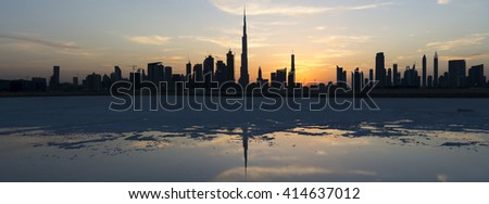 This is one in a series of photographs of Dubai at sunset from the Design District. This part of Dubai Creek has been dammed and most of the water has evaporated over time, leaving the salt deposits.