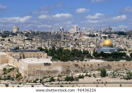 This is panorama of Jerusalem city. Photo contains ancient building, domes and modern architecture on the background.