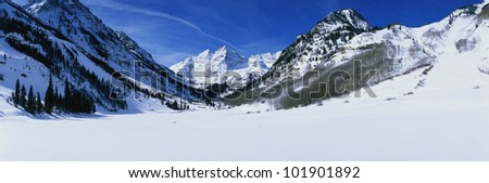 This is Pyramid Peak in the Maroon Bells after a winter snow storm. The altitude is 14,010 feet. - stock photo