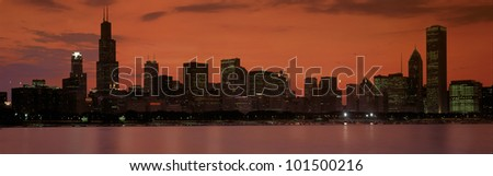 This is the complete Chicago skyline with the Chicago Harbor in the foreground. It is the view at sunset during summer. - stock photo